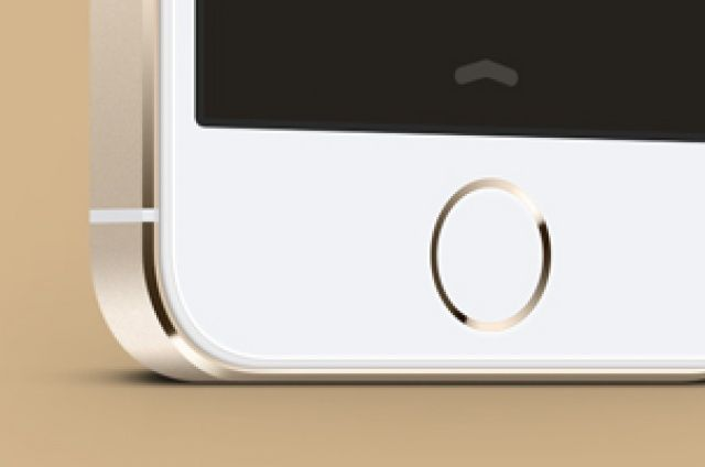 A three-quarter perspective iPhone 5S vector mockup in gold, white and black. Sc…