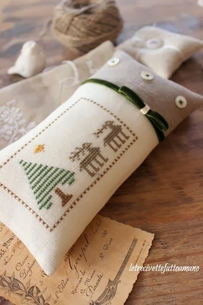 """Hello my friends.I have a beautiful stitcher's finish to show you. Sent in by Monica, who's blog is http://www.letrecivettefattoamano.com/ She has stitched my freebie """"Woodland Deer""""It is so sweet. She finished it into a long pin pillow with a few buttons..."""