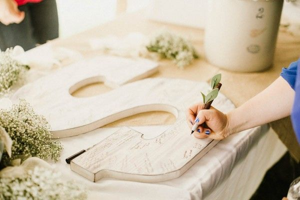 We're loving this non-traditional guest book that can also be used as a home décor piece after the wedding! I Photo by Glasser Images ... via http://junebugweddings.com/wedding-blog/lace-burlap-wedding-north-dakota/