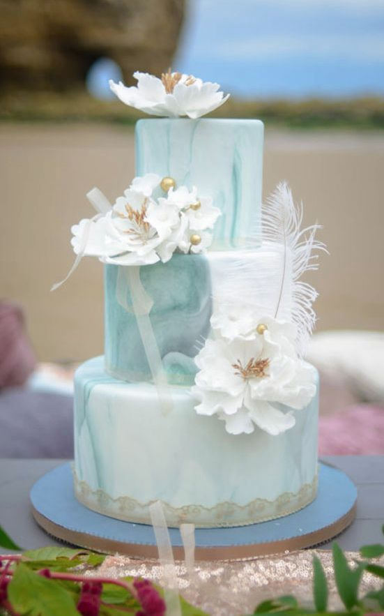 Chic and unique three tier turquoise marble wedding cake topped with white flowers; Featured Photographer: Kimberley Waterson Fine Art Photography