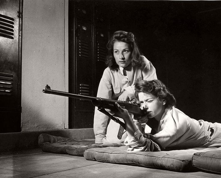 Two women conduct marksmanship training at Roosevelt High School Los Angeles 1942