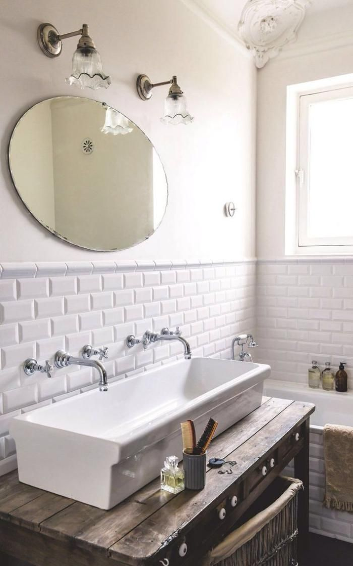 "double wall-mounted faucet.... ""trough"" sink works with antique wood vanity stand 