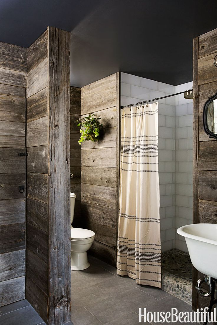 In this Southborough, Massachusetts, country bathroom by Andrew and Yvonne Pojani, the design is all about the warm, reclaimed barn wood on the walls.