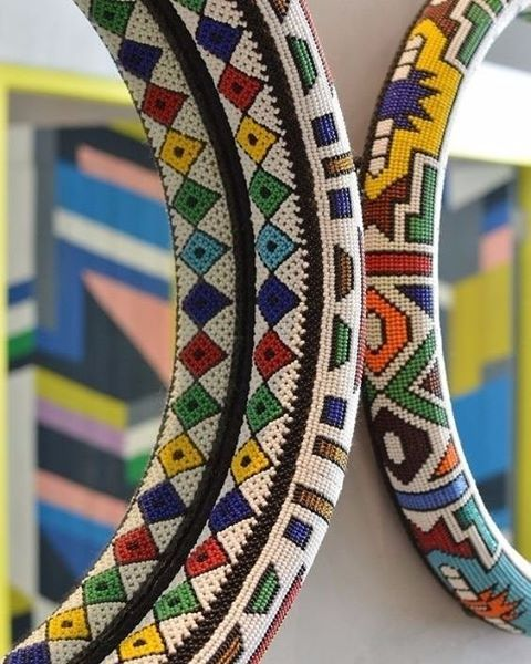 Ndebele inspired beaded mirrors hanging proudly at @nandosuk in South Africa.