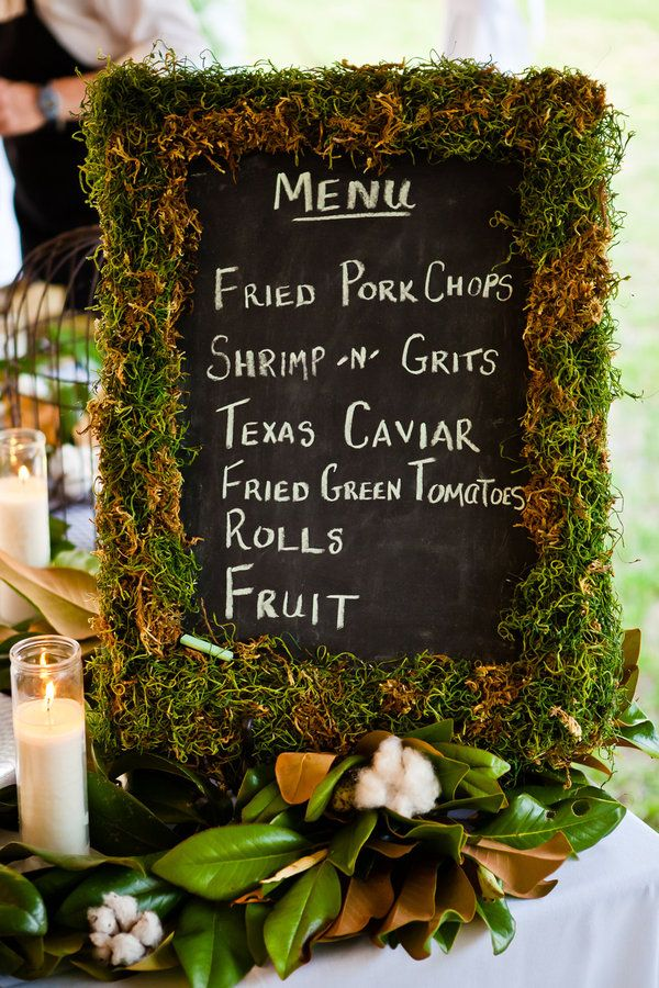 Great Southern menu board with moss surrounded with magnolia leaves