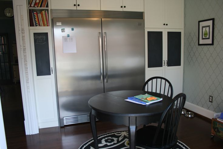 """Frigidaire Professional series """"all refrigerator"""" and """"all freezer"""" tied together with the trim kit to look like built-ins; chalkboard paint on cabinets"""