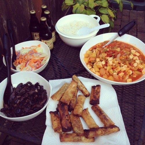 Filipino vegan dinner with lumpia, adobo, afritada, cucumber salad and rice