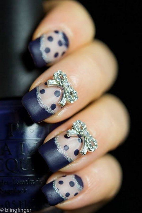 Blue and silver bow nail art. Top up your blue French tip and polka dot design with silver glitter paint. It's never too late to go one step ahead by adding silver bow embellishments on top of the nails.