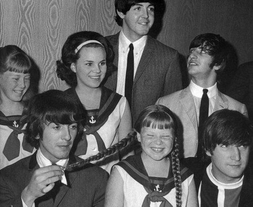 George Harrison takes a closer look at a braided pony tail, causing giggles on girl school photo with the beatles | via Stylish Little Girls ~ Cityhaüs Design