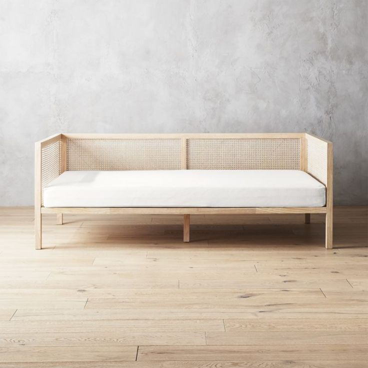 Shop Boho Natural Daybed with Pearl White Mattress Cover.   The perfect setting for daily siestas.  Designed by Mermelada Estudio in Spain, graceful daybed approaches sofa styling with the relaxed comfort of a bed.