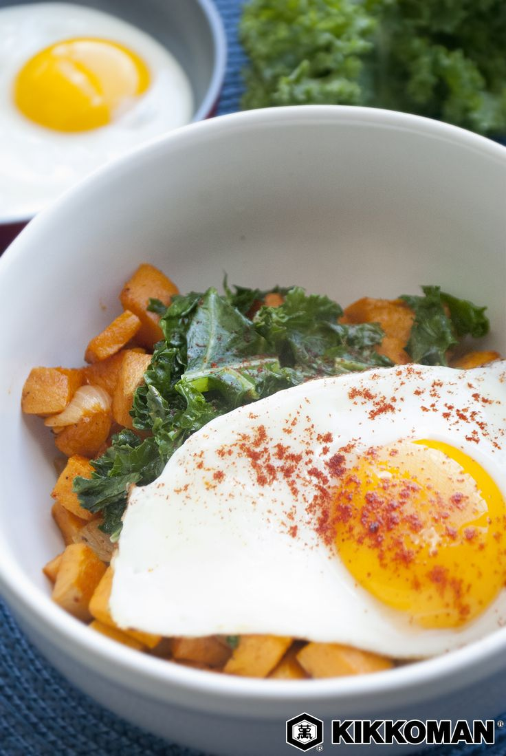 Sweet Potato + Kale Breakfast Bowl   For those days when cereal or yogurt and fruit just won't cut it, this hearty breakfast bowl is just what you need for the most important meal of the day. Roasted sweet potatoes are seasoned with Kikkoman®️️️ Soy Sauce and smoked paprika, then tossed with kale and topped with a fried egg.   Find easy and inspiring recipes for every meal at KikkomanUSA.com.