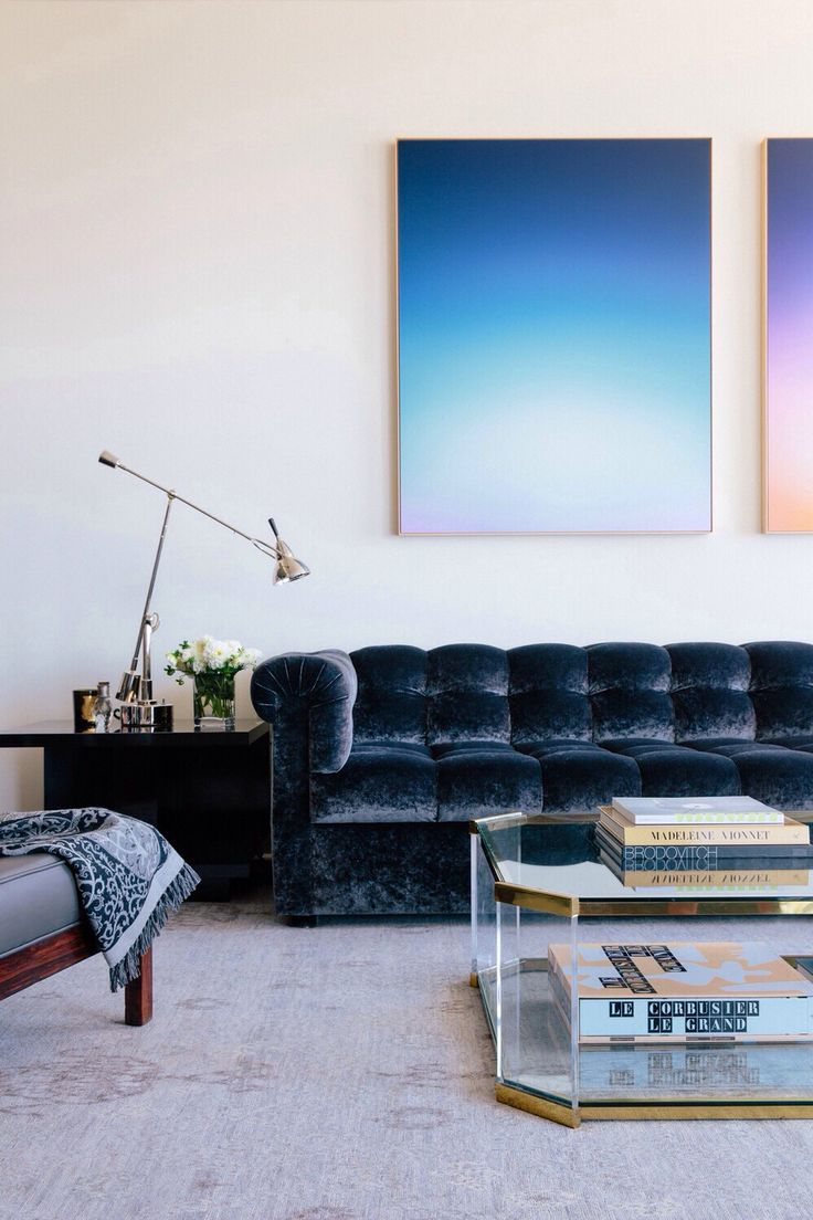 Love that ombre artwork and dark couch.
