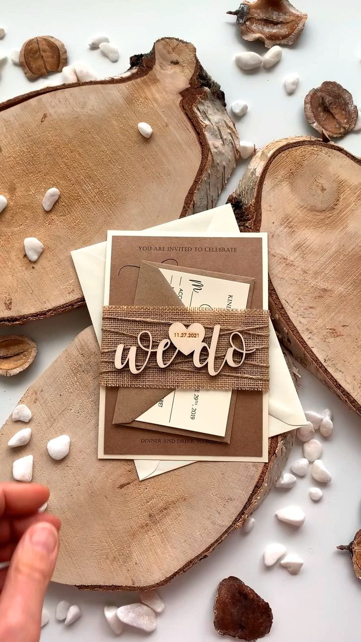 We Do Wedding Invitations inspired by rustic and country weddings. The addition of the paper contrast color and natural burlap and personalized heart with date and We Do made from wood on the belly band turns this invitation simply perfect.   #custominvitation #weddinginvites #rusticweddinginvitations #woodenweddinginvitations #wedoweddinginvitations #countryweddinginvitations #lasercutweddinginvitations #personalizedweddinginvitations #rusticweddingideas #rusticweddinginvites