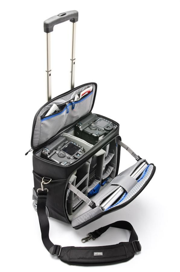 Airport Navigator by ThinkTank - amazing bag.  Perfect size for all my main wedding kit, and opens in two spots which is much easier than having to lay it flat when running around the city taking portraits.  Holds my 2 main bodies and all the lenses apart from the 24.
