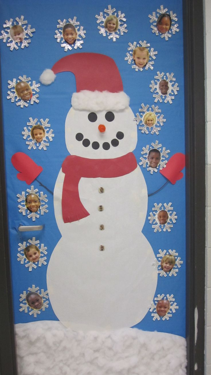 A very cute Frosty the Snowman classroom door display that includes snowflakes with students' face in the middle of them.