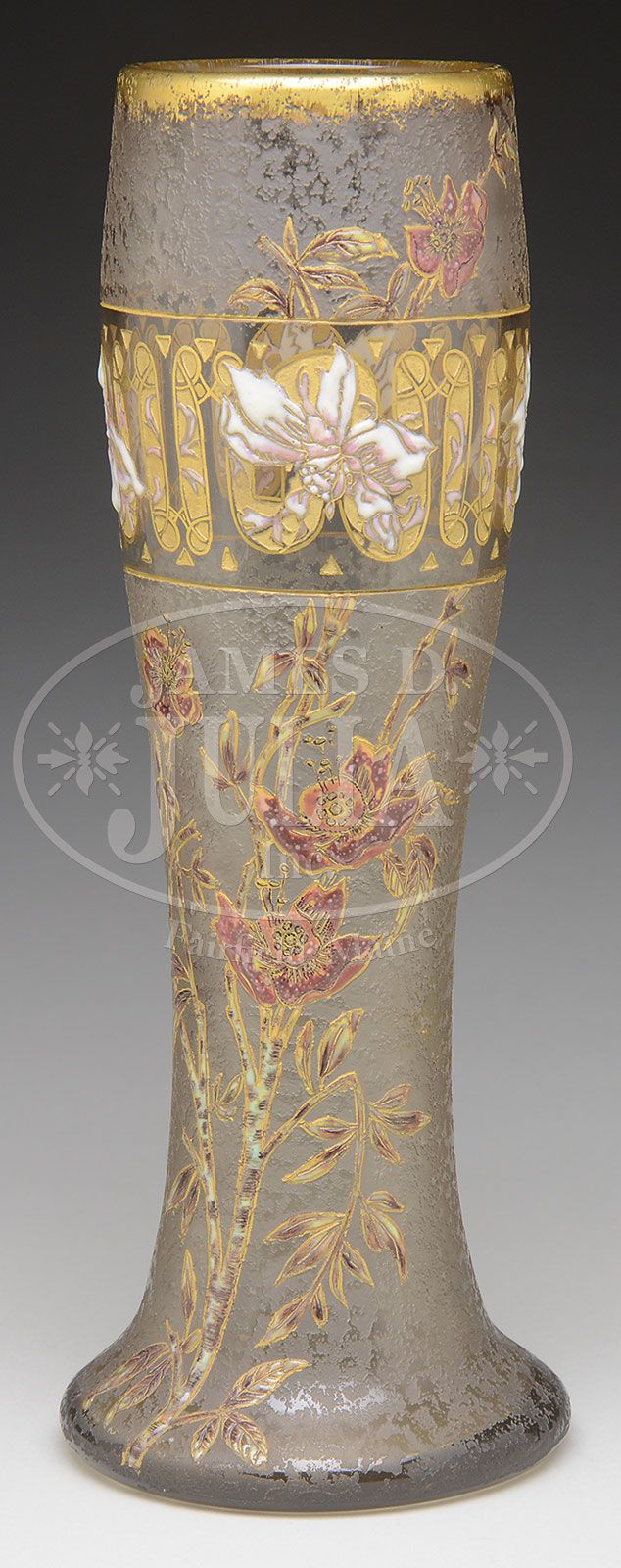 "DAUM NANCY CAMEO AND ENAMELED VASE. Early Daum vase is decorated with a sprig of foliage rising from the foot having light green and brown branches leading to deep burgundy and pink blossoms, all with gilded highlights and set against an acid-textured background. Vase is further decorated with a band of stylized gilding with enameled pink and white flower blossoms set against a section of clear background and gilded top rim. Signed on underside ""Daum Nancy"" with Cross of Lorraine."