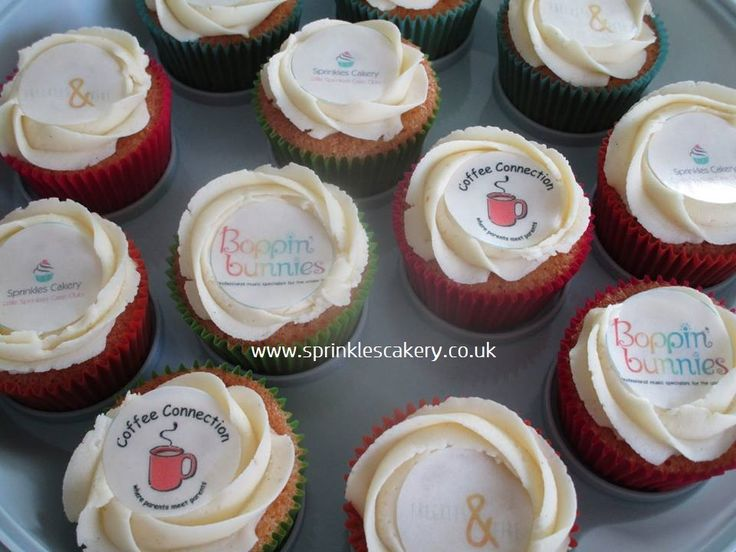 Here are some basic buttercream swirl cupcakes topped with a disc of wafer paper (edible) printed with company logos.
