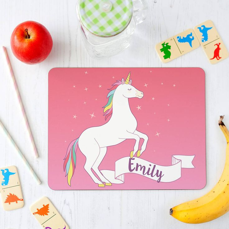 A fabulously magical unicorn placemat for children. Make mealtimes more fun with this fabulous unicorn placemat for children. Available in pink or teal and personalised with their name. An easy way to protect the table while encouraging children to start helping set the table - These are high quality, glossy, and durable place mats and coasters that can be easily wiped down after mealtimes. Designed and printed in London by The Little Picture Company. Hardboard placemats with a high gloss…