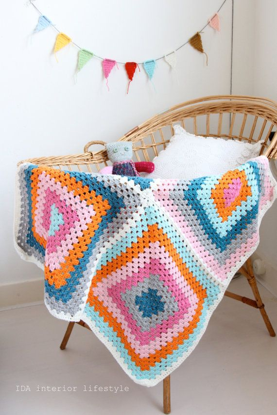 giant crochet granny square baby blanket and flags
