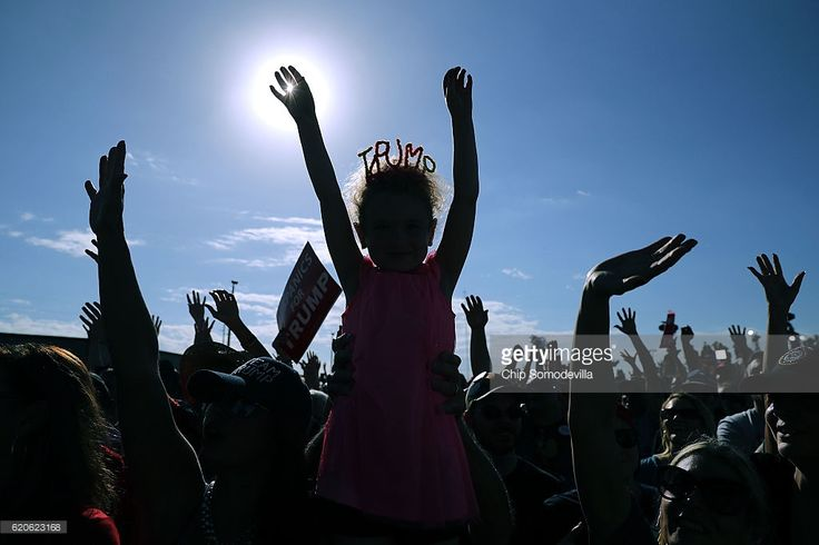 Amelia Good, 6, wears a crown made from pipe cleaners during a campaign rally with Republican presidential nominee Donald Trump at the Orlando Amphitheater at Central Florida Fairgrounds November 2, 2016 in Orlando, Florida. With less than a week before Election Day in the United States, Trump and his opponent, Democratic presidential nominee Hillary Clinton, are campaigning in key battleground states that each must win to take the White House.