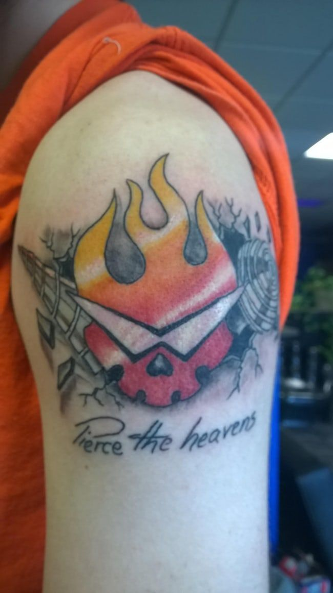 This Gurren Lagann Bicep Tatto is listed (or ranked) 25 on the list 30 Gorgeous Anime Tattoos You Would Actually Get