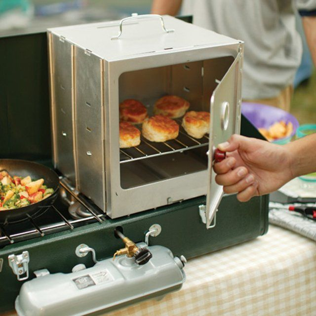 This smart Coleman oven turns your gasoline or propane camp stove into a campsite bakery! Handy oven folds out in a flash and takes its heat from the top of your two- or three-burner stove. Perfect for baking or keeping foods warm, the oven comes with a 10-inch-square wire rack, large enough for mini pizzas and small batches of cookies. Rack can be set to three different cooking heights to accommodate a variety of baking needs. Comes with an easy-open door latch, top carry-handle and an…