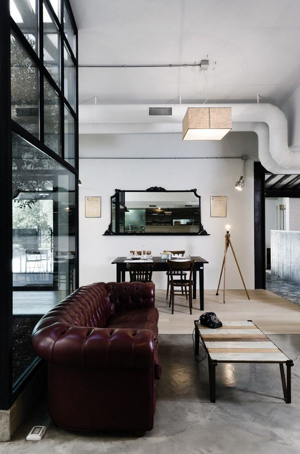 loft + glass + concrete + leather chesterfield