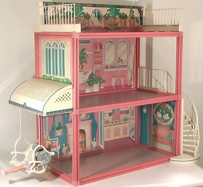 I spent hours playing with this Barbie house when I was a kid!