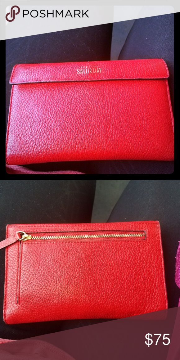 Kate Spade Travel Wallet SALE! only used for a few months. 8 slots for credit cards, zipper pouch, place for bills, and a place to hold your passport! great to have everything in one spot! Selling cheaper on ?ercari! kate spade Bags