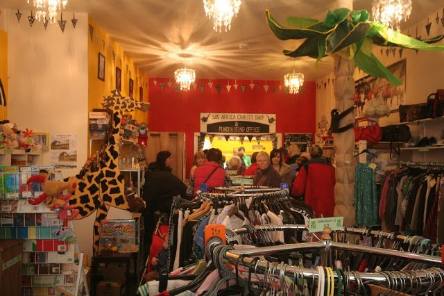 Have you ever seen an #African #CharityShop with a Giraffe, palm tree and monkey #fundraising meter?