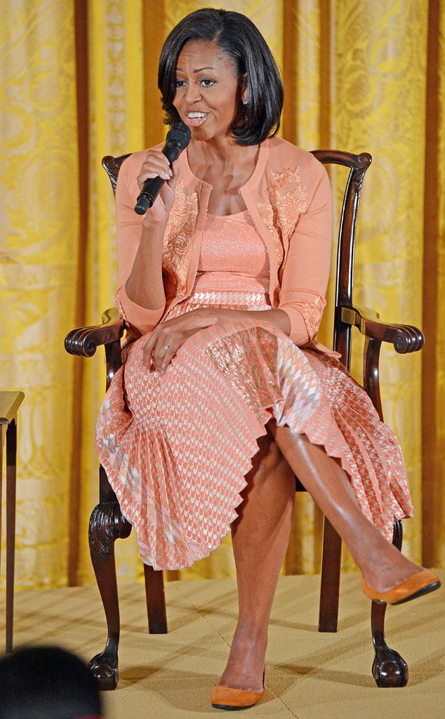 Peachy Keen from Michelle Obama's Best Looks  FLOTUS pairs her peach-hued skirt and sweater ensemble with bright orange flats at the White House's annual Take Our Daughters and Sons to Work Day.