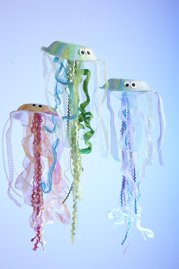 J - How to Make Your Own Jellyfish Kids Craft!  Let the kids make some jellyfish out of paper plates and ribbon. Hang them up and let the deep sea adventures begin!   Now, I have that song Under the Sea stuck in my head. Dang you LIL Mermaid!