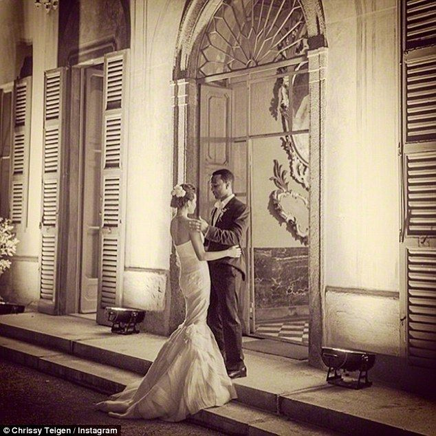 'We do!' The couple walking down the aisle in September 2013 in a lavish ceremony which saw the cover girl wear two wedding dresses