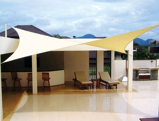 TENSILE STRUCTURE [USD 800].  The tensile fabric can be stretched across the outdoor classroom to provide shade for this small space