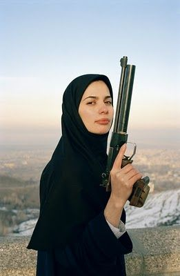 This gun is called revolution - girls with guns in the Middle East, your American sisters wish you well in gaining greater liberties.  Courage- aim well!!!!