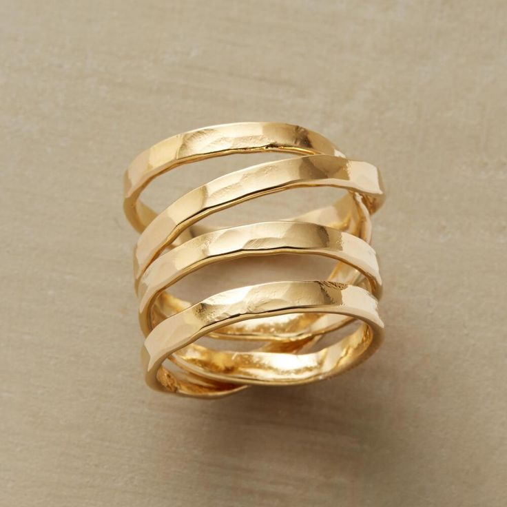 COMET'S PATH RING -- Our hand-hammered 14kt gold-plated spiral ring orbits your finger with otherworldly grace. USA. Whole sizes 5 to 9.