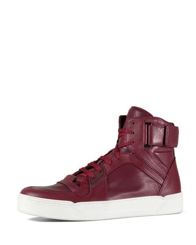 $840 red leather high-top basketball shoe by Gucci at Neiman Marcus.  I not sure how a feel about these?  Cool or an example of consumerism gone mad?