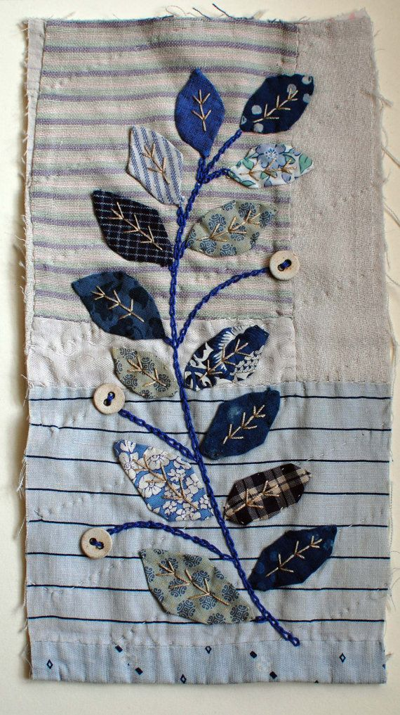 The base for this is an old bit of quilt in blues and whites. I have used a piece near the edge of the quilt which gives it quite a nice detail at the bottom. Appliquéd leaves of different fabrics including some authentic japanese fabrics and liberty prints. finger turning the edges. stem is chain stitched.Mandy Pattullo