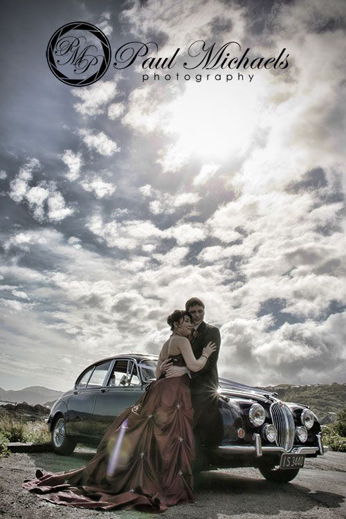 Bride and groom with the car. New Zealand #wedding #photography. PaulMichaels of Wellington www.paulmichaels.co.nz