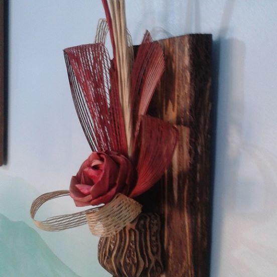 "Fernwood wall hanging, ""Ponga"" vase on a Mamaku fiber base, teamed with an Artiflax flower"