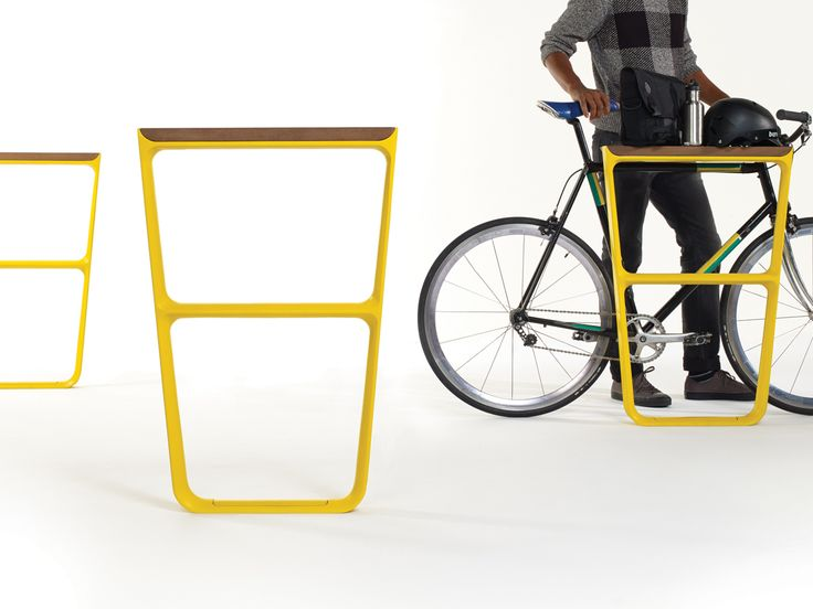 How Do You Design the Perfect Bike Rack or Park Bench?   The bike racks act as shelves for cyclists.  Fuseproject    WIRED.com