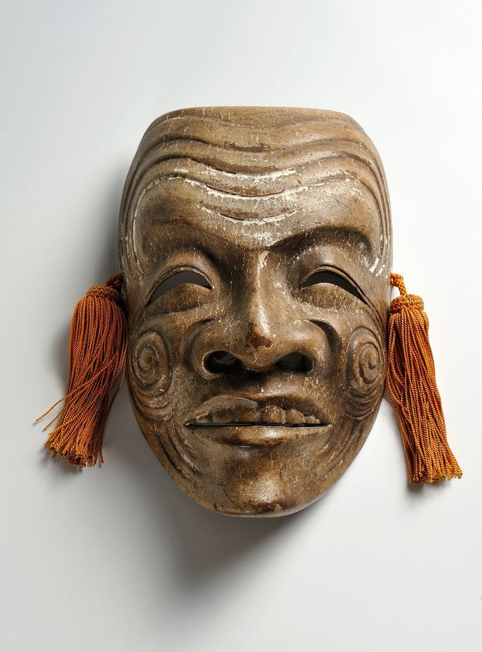 An Okina Noh mask - Polychromed wood.  Japan, early 20th century. Height 19 cm.  Asia
