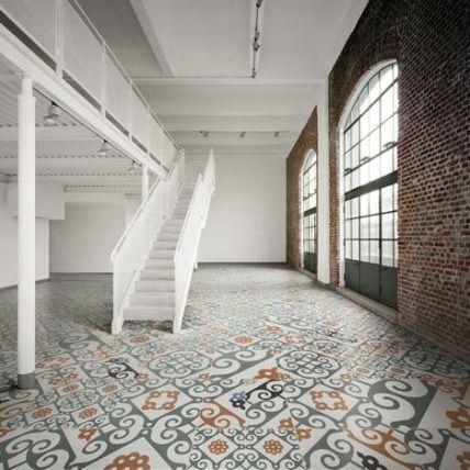Loving the mismatched vintage tile floors!