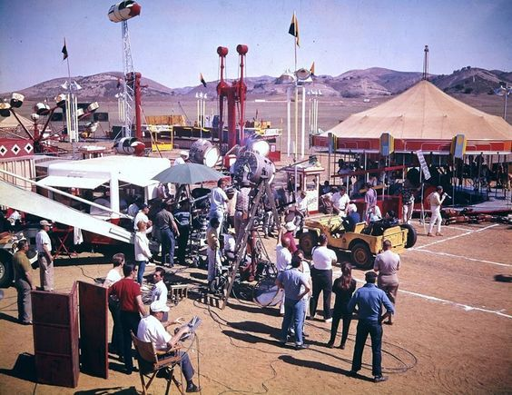 Roustabout 1964 = Barbara Stanwyck and Elvis (sitting in the jeep) On location in Thousand Oaks, California for the movie