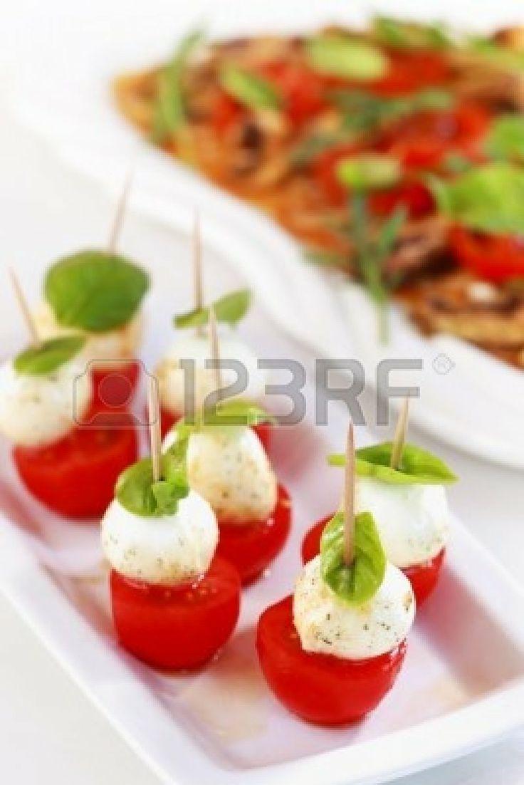 Delicious appetizer - mozzarella cheese with tomato and champignon carpaccio Stock Photo - 12251506