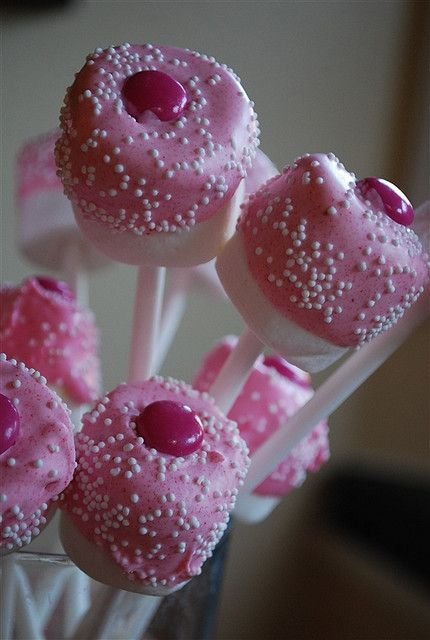 """""""I just placed a large marshmallow on the end of a sucker stick and then dipped half the marshmallow into melted chocolate.  I just added some pink food coloring into white chocolate melts but you can also purchase pink ones.  I added some white sprinkles and a pink M & M on the top (thank goodness for Breast Cancer Awareness M & M's)"""""""