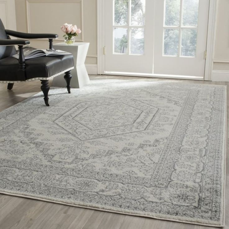 """Promising review: """"I was in love as soon as I unrolled it. It's the perfect pattern without all the color that Oriental rugs usually have. Perfect for my neutral farmhouse style decor. It's not very plush so it will require a felt pad under it to thicken it up a bit but the quality, color, and pattern make this rug worth every penny!."""" —Gabrielle CollierPrice: $24.98+ / Rating: 4.4/5 / Sizes: Available in 34 sizes. / Colors: Available in seven colors."""