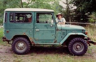 My dream car! A toyota FJ40 (In that color too) ...How cute would it be with the back filled to the brim with fresh flowers and a golden retriever hanging his head out the window!?