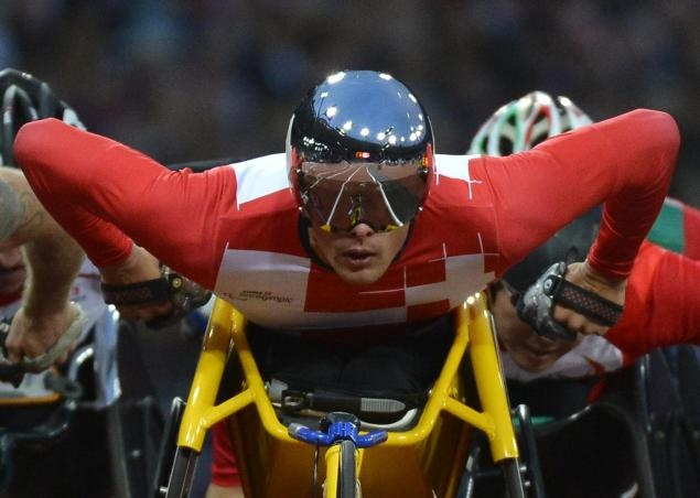 TOBY MELVILLE/REUTERS    Marcel Hug of Switzerland races to win his Men's 5000m T54 Classification heat at the Olympic Stadium during the London 2012 Paralympic Games.