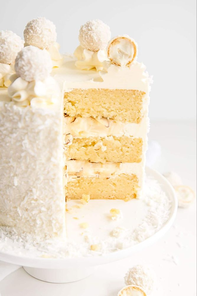 Cross Section Of A Raffaello Cake With Almond Cake Layers And Coconut Cream Custard Almond Cream Cake Recipe Coconut Cake Decoration Coconut Chocolate Cake